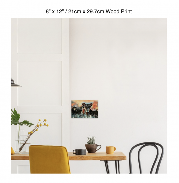 12 inch by 8 inch wood print of a lioness hanging over a dining table