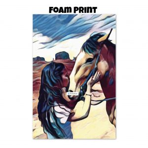 Foam print of a woman kissing a horse on the nose in front of a desert background