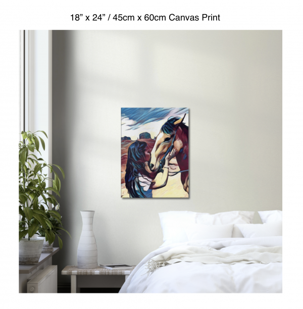 18 inch by 24 inch canvas print of a woman kissing a horse on the nose in front of a desert background hung on the wall above a white bed