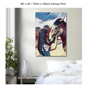28 inch by 40 inch canvas print of a woman kissing a horse on the nose in front of a desert background hung on the wall above a white bed