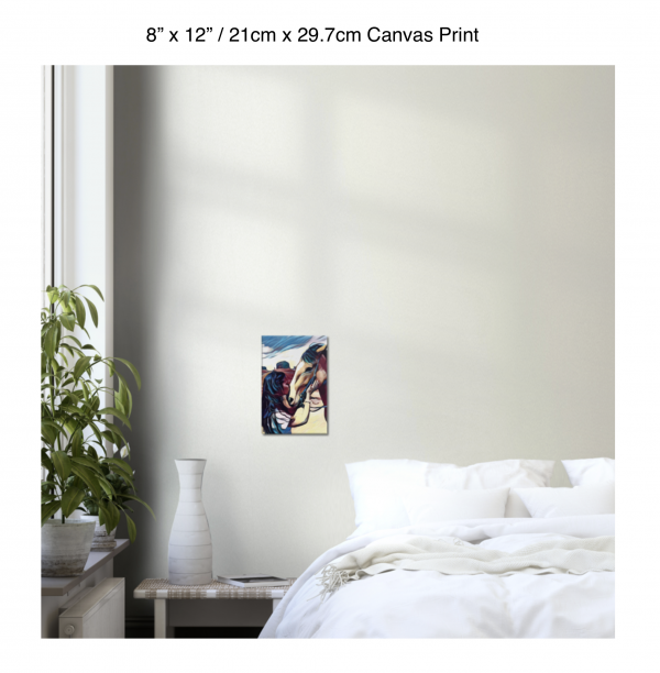 8 inch by 12 inch canvas print of a woman kissing a horse on the nose in front of a desert background hung on the wall above a white bed