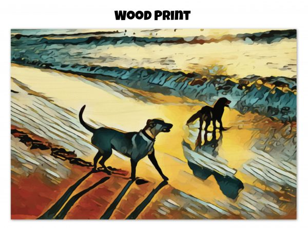 Wood print of two dogs wading in the surf in golden tones of a sunset